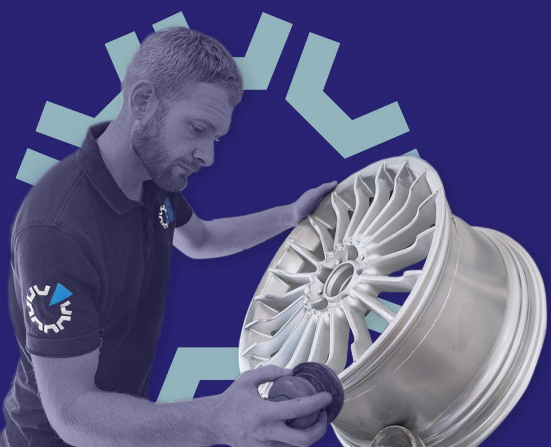 Diamond alloy technicians technician working on a wheel